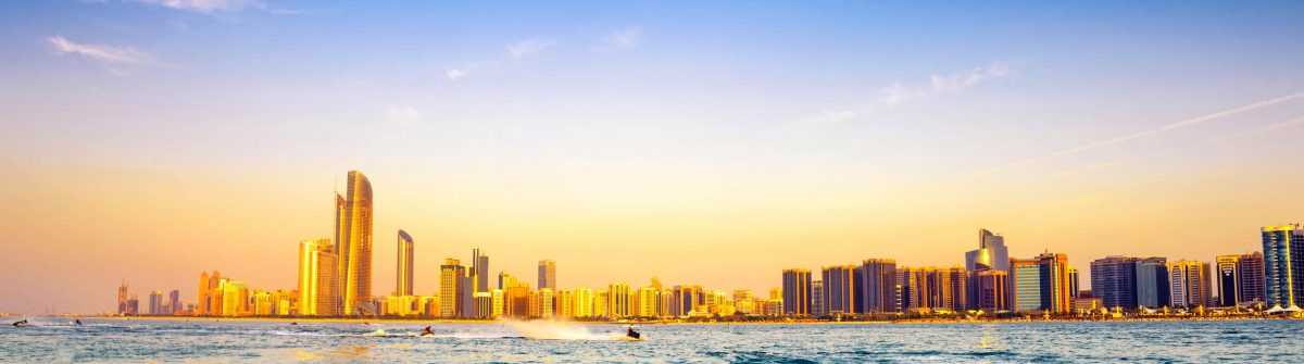 Beach-with-backdrop-of-Abu-Dhabi-skyline-at-sunset-VAE-iStock_000022783355_Large-2