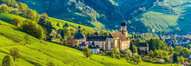 Beautiful-countryside-mountain-landscape-with-a-monastery-in-village-shutterstock_286284614-2