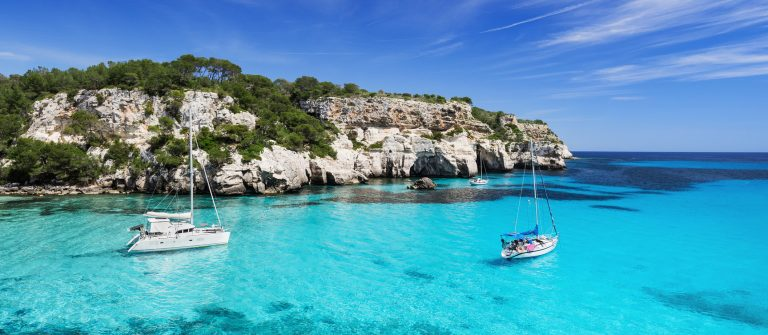 Beautiful bay in Mediterranean sea with sailing yachts