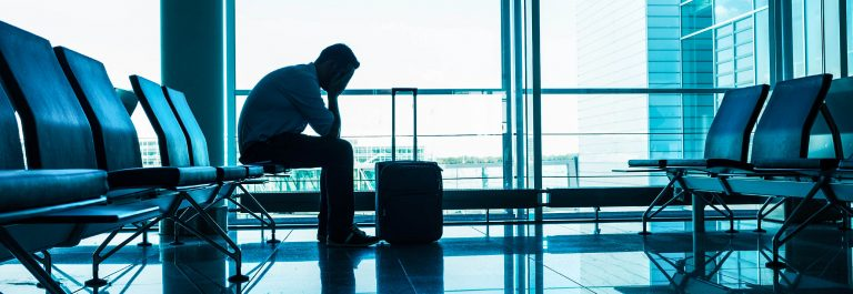 Unhappy-passenger-waits-for-flight-at-airport-iStock_000071225575_Large-2