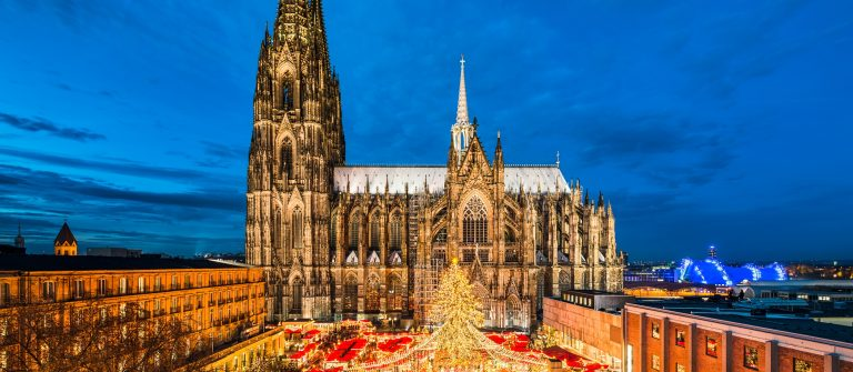 Christmas-market-in-front-of-the-Cathedral-of-Cologne-Germany-shutterstock_694776442