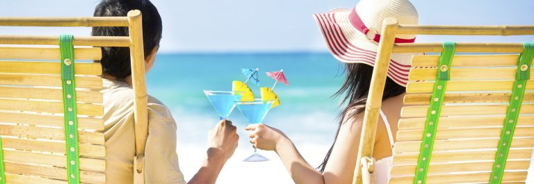 Romantic-Couple-on-Beach-Drinking-iStock_000066184035_Large-Copy