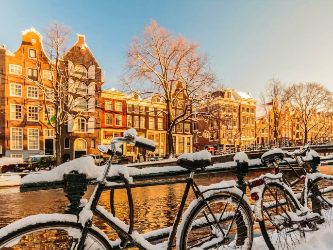 Bicycles-covered-with-snow-during-winter-in-Amsterdam-iStock_30879410_XLARGE-2