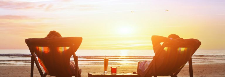 happy-couple-enjoy-luxury-sunset-on-the-beach-during-summer-vacations-shutterstock_265026164