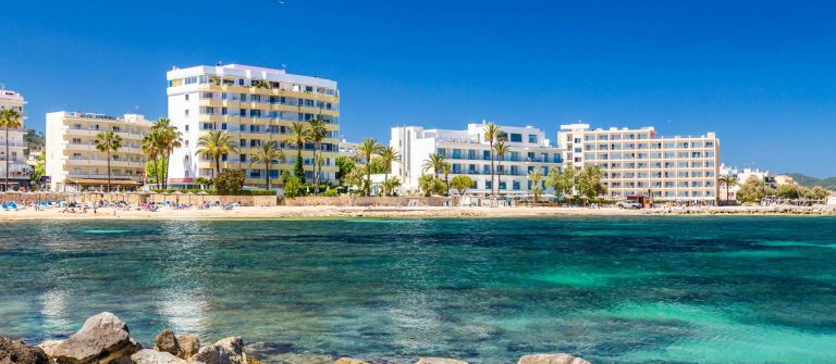 Beach-and-hotels-of-touristic-town-Cala-Millor-Majorca-Spain-iStock-609079828-2