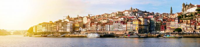 Sunset cityscape of Porto old city under the river, Portugal