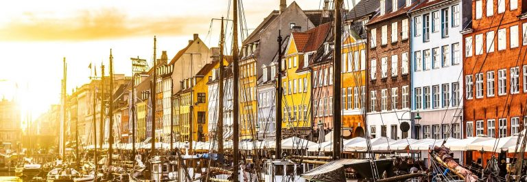 Colorful-houses-in-Copenhagen-old-town-at-sunset-Denmark-shutterstock_379866352-2-1