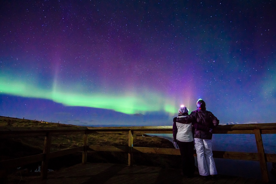 Couple admires northern lights in Iceland