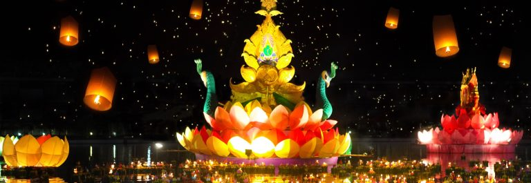 Big-and-small-boats-with-candles-and-flowers-are-given-for-Thailands-traditional-Loy-Krathong-Festival.-Sky-lanterns-in-the-sky_shutterstock_252804616