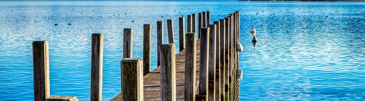 old-wooden-jetty-at-the-chiemsee-lake-in-bavaria-shutterstock_237279748-2-1