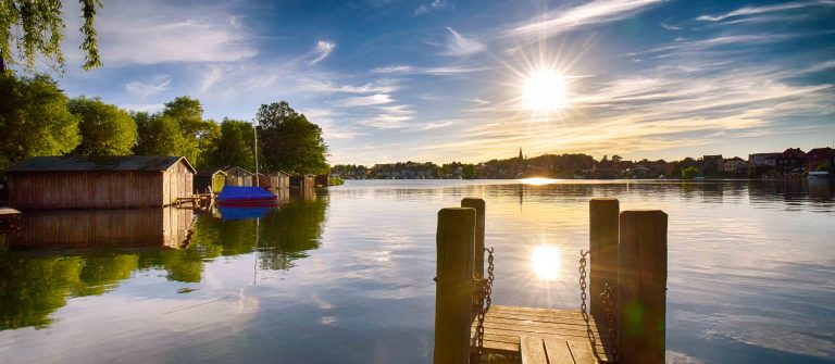 Sunset on the lake with jetty in Malchow (Mecklenburg-Vorpommern / Germany)